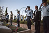Israel Police Commissioner, Yohanan Danino (3rd from right) salutes fallen Commander Shimon Gabai after placing a small flag on his grave. Gabai is the most recent Israel Police officer dead. Jerusalem, Israel. 22-Apr-2012.