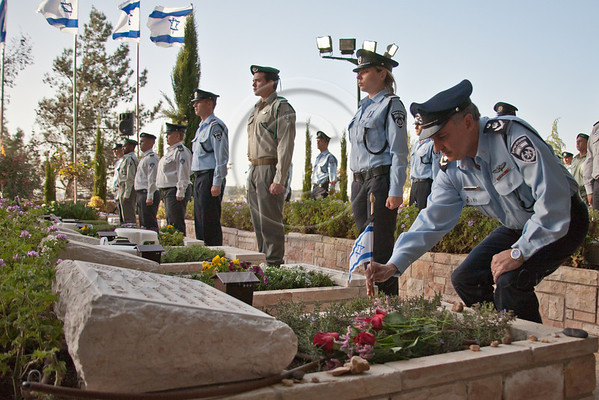 Israel Police Commissioner, Yohanan Danino, leads a pre-Memorial Day ceremony in which small flags are placed on the graves of all 1,418 fallen police officers nationwide, beginning with the last deceased, Commander Shimon Gabai. Jerusalem, Israel. 22-Apr-2012.