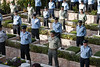 Policemen stand at attention during a pre-Memorial Day ceremony with families of the dead in the Police Section of the Mt. Hertzel military Cemetery. Jerusalem, Israel. 22-Apr-2012.