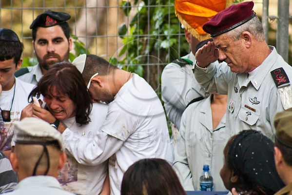 IDF Chief of Staff, Lieutenant General, Benny Gantz, salutes Lieutenant Hila Betzaleli, 20, killed last week after being struck by a collapsing steel lighting fixture during rehearsal for Remembrance Day ceremony, as grieving mother weeps. Jerusalem, Israel. 22-Apr-2012.