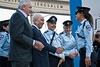 President Shimon Peres shakes the hand and congratulates Sergeant Major Marlen Hadad, the only female motorcycle traffic policewomen in a unit of ninety men, for her extraordinary conduct and contribution. Jerusalem, Israel. 23-Apr-2012.