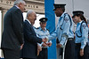 President Shimon Peres shakes the casted hand and congratulates Advanced Staff Sergeant Major Hadar Marsha, leaning on a crutch and still recovering from an on-duty injury, for his extraordinary conduct and contribution. Jerusalem, Israel. 23-Apr-2012.