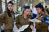 Female IDF officers serve as ushers to assist visitors at Mt. Hertzl Military Cemetery on Memorial Day. Jerusalem, Israel. 25-Apr-2012.<br /> <br /> Tens of thousands of families and friends of 22,993 fallen IDF soldiers and terror victims assemble in the Mt. Hertzl Military Cemetery to pay their respects on Memorial Day. An estimated one million will visit cemeteries today nationwide.