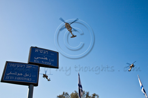 Israel Air Force salutes the President with a 3-helicopter flyover above the Presidential Residence on the morning of Israel's 64th Independence Day. Foreground sign indicates left to Jabotinsky Street and right to the President's Boulevard. Jerusalem, Israel. 26-Apr-2012.