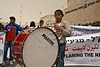 A young boy sounds a drum in rhythm with demonstrators chanting slogans in a Bedouin demonstration at KKL-JNF offices protesting alleged land-grab attempts despite ongoing legal proceedings. Jerusalem, Israel. 29-Apr-2012.