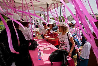 Women of all ages and races take part in a festive celebration of femininity at Sacher Park prior to the start of Komen's second annual Israel Race for the Cure. Jerusalem, Israel. 3-May-2012.