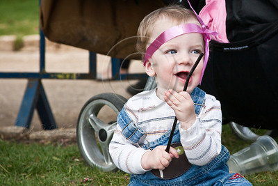 A baby girl is decorated with a pink ribbon as women of all ages and races take part in a festive celebration of femininity at Sacher Park prior to the start of Komen's second annual Israel Race for the Cure. Jerusalem, Israel. 3-May-2012.