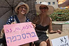 """Two young Jerusalem Slut Walk participants carry a Hebrew sign reading """"We want it only by consent"""". Jerusalem, Israel. 4-May-2012."""