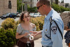 Organizer Sarit Shashkes submits to order by Police Captain Alon Veinstein to button up her blouse at onset of Slut Walk Jerusalem as he threatens criminal action against her and withdrawal of police forces securing the march. Jerusalem, Israel. 4-May-2012.