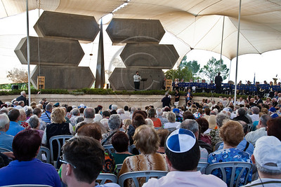 Ceremony commemorating Allied victory over Nazi Germany takes place at Yad Vashem Holocaust Museum below a stone monument in memory of Jewish soldiers and partisans who lost their lives in WW II. Jerusalem, Israel. 9-May-2012.