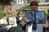 A woman holds up photos of loved ones lost in World War Two as veterans from around the country assemble in Jerusalem for a colorful march celebrating Allied victory over Nazi Germany. Jerusalem, Israel. 9-May-2012.