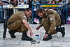 Two IDF sergeants shine their shoes before the beginning of a ceremony at the Western Wall. Jerusalem, Israel. 10-May-2012.