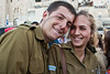 Private Nadav Paldi poses for photo with Corporal girlfriend before beginning of his oath of allegiance ceremony at the Western Wall. Jerusalem, Israel. 10-May-2012.