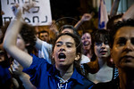 A young woman wearing the blue shirt and white lace of the Shomer HaTzair youth movement passionately takes part in the social justice demonstration outside the PM?s residence. Jerusalem,  ...