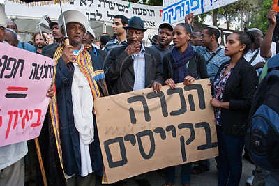 Ethiopian protesters hold a sign demanding recognition of the rabbinical authority of the keisim religious leaders. Jerusalem, Israel. 23-May-2012.