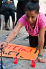 A young Ethiopian woman paints signs in preparation for a demonstration against racial discrimination near the PM's residence. Jerusalem, Israel. 23-May-2012.