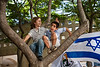 Two young boys play at an inauguration ceremony for an art installation by designer Smadar Carmeli at Kikar Safra City Hall Square. Jerusalem, Israel. 31-May-2012.