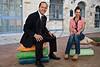 Mayor Nir Barkat and art designer Smadar Carmeli sit on concrete, but very life-like cushions, part of an art installation by designer Smadar Carmeli, at Kikar Safra City Hall Square. Jerusalem, Israel. 31-May-2012.