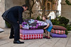 Mayor Nir Barkat fools around with a young boy pretending to try to pick up concrete, but very life-like cushions, part of an art installation by designer Smadar Carmeli, at Kikar Safra City Hall Square. Jerusalem, Israel. 31-May-2012.