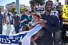 A man demonstrates with an infant representing families who might be evicted from the Ulpana neighborhood near Beit-El if government does not oppose Netanyahu's decision to comply with High Court of Justice ruling. Jerusalem, Israel. 3-June-2012.