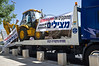 Protesters bring in a bulldozer to symbolize destruction of the Ulpana neighborhood homes that they are trying to prevent. Government Quarter security man confronts conveyor truck driver and demands he moves on. Jerusalem, Israel. 3-June-2012.
