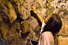 In an underground tunnel beneath the Western Wall, actress Vanessa Marcil Giovinazzo pushes a note of prayer into a crevice between the stones, during a tour hosted by Tourism Ministry. Jerusalem, Israel. 4-June-2012.