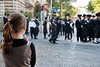 "A young girl stands and observes the excitement as ultra-Orthodox Haredim renew their battle over the closure of Haneviim, The Prophet's Road, on the Jewish Sabbath attempting to physically block traffic and shouting ""Shabess"" at passing drivers. Jerusalem, Israel. 9-June-2012."