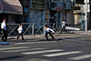 Young ultra-Orthodox Haredi boys run after placing a police barrier on Haneviim, The Prophet's Road, in an attempt to physically block traffic as Haredim renew their battle over closure of the street to traffic on the Jewish Sabbath. Jerusalem, Israel. 9-June-2012.