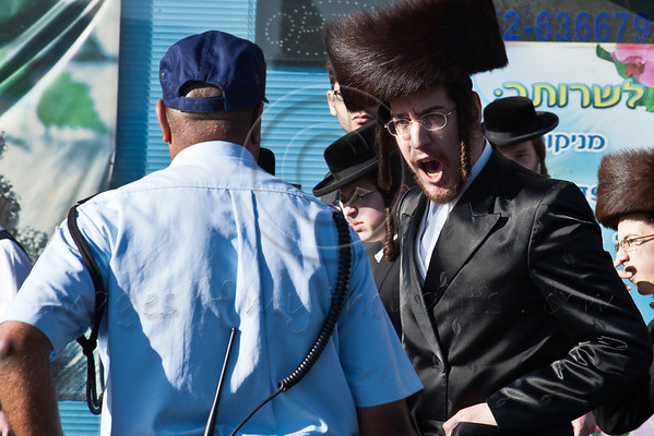 "An ultra-Orthodox Haredi shouts ""Shabess"" at a policemen deployed to keep the road open as Haredim renew their battle over the closure of Haneviim, The Prophet's Road, on the Jewish Sabbath attempting to physically block traffic. Jerusalem, Israel. 9-June-2012."