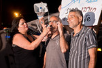 Activist Shimon Nachmani (center) speaks to protesters assembled near Pat Junction as they assemble for an evening of protest demanding housing opportunities and social justice. Jerusalem, I ...