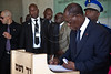 Coming out of the Children's Memorial Hall, President of Ivory Coast, Alassane Ouattara, signs the guest book at Yad Vashem Holocaust Museum. Jerusalem, Israel. 17-June-2012.