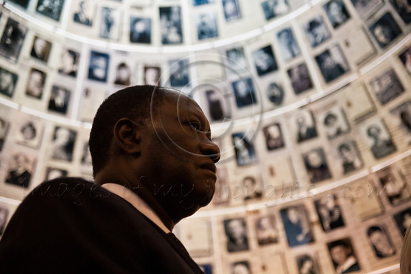 President of Ivory Coast, Alassane Ouattara, and wife, Dominique Quattara, receive instruction from Irena Steinfeld, as they gaze up at enlarged Pages of Testimony displayed on the ceiling of the Hall of Names at Yad Vashem. Jerusalem, Israel. 17-June-2012.