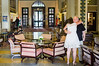 A man and woman hug in the King David Hotel elegant and luxurious lobby. The hotel has hosted many important dignitaries in its rich history including President Bush, Prince Charles, Prince Phillip, Ben Kingsley and Mohammed Ali. Jerusalem, Israel. 19-June-2012.