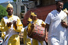 Ethiopian Christian pilgrims walk the streets of Ein-Karem to St. John BaHarim Church, wearing ceremonious yellow robes and singing with spiritual joy. St. John BaHarim, or Yochanan BaHarim in Hebrew, is the tradition birthplace of John the Baptist. Jerusalem, Israel. 23-June-2012.