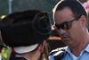Police officer gives Haredi protester an up-close, stern, look. Jerusalem, Israel. 23-June-2012.
