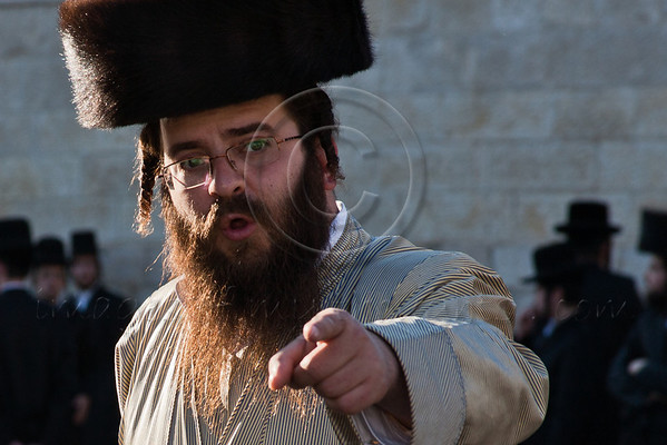 Hasidic man of Toldos Aharon, an extreme anti-Zionist Hasidic movement, stationed in Meah Shearim neighborhood, dressed in tradition Sabbath clothes and a fox-fur Shtreimel, objects to being photographed on the Sabbath. Jerusalem, Israel. 23-June-2012.