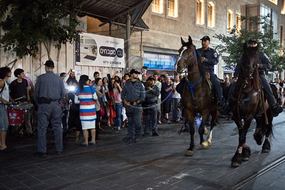 Police use force and eventually horses to prevent protesters from disrupting tram traffic during a demonstration for social justice. Jerusalem, Israel. 24-June-2012.