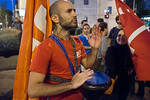 Social justice protester beats on a darbuka drum to the beat of slogans being shouted in the air. Jerusalem, Israel. 24-June-2012.