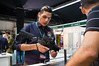 A salesman demonstrates firearms at Combat 2012 trade fair. The Israeli security industry has made a name for itself world wide. Tel-Aviv, Israel. 26-June-2012. <br /> <br /> Homeland Security and Combat international exhibitions open at Israel Trade Fairs Center for three days, sponsored by the Ministry of Trade and Industry in cooperation with IHS Jane's Defense & Security Intelligence & Analysis.