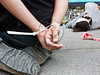 The hands of a human rights activist-actor are tied behind his back protesting alleged torture of prisoners in interrogation. Jerusalem, Israel. 5-July-2012.