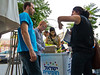 Be Free Israel activists sign up new members for the Be Free Jerusalem consumer group giving members discounts at participating businesses. Jerusalem, Israel. 12-July-2012.<br /> <br /> Be Free Israel stage a rally to introduce new Be Free Jerusalem consumer group supporting businesses open on the Jewish Sabbath in violation of municipal regulations to promote freedom of religion and pluralism in Israel as core democratic values.