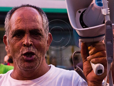 A social welfare protester with an angry face outside the Prime Minister's residence. Jerusalem, Israel. 15-July-2012.