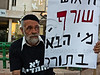 "Demonstrator carries a sign which reads in Hebrew ""Despair burns. Who is next?"" referring to Moshe Silman, who lit himself up yesterday in Tel-Aviv protesting his social and economical difficulties. Jerusalem, Israel. 15-July-2012."