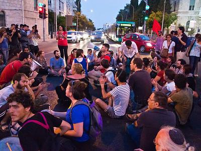 "Social welfare activists sit on King George Street at Kikar paris Square obstructing traffic and chanting ""We are all Moshe Silman!"". Jerusalem, Israel. 15-July-2012."