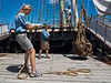 Museum employees demonstrate old-fashioned unloading of ships using ropes and winches. Mystic, Connecticut, USA. 21-July-2012.<br /> <br /> Mystic seaport is the nation's leading maritime museum consisting of a village, ships and 17 acres of exhibits depicting coastal life in New England in the 19th century.