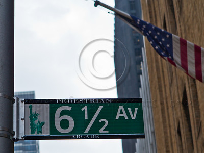 Street sign indicates 6 ½  Avenue (Six and a Half Avenue) on 53rd Street in Manhattan. New York, New York, USA. 24-July-2012. New York, the most populous city in the US, the cultural and financial capitals of the world, is overwhelming. Diversity is tremendous and the rhythm and power of the city vertiginous. They say you either love it or hate it - I am still undecided.