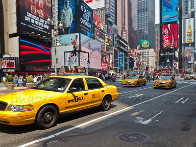 Typical NYC yellow taxi cabs on Broadway and 42nd Street, also known as Times Square, Manhattan. New York, New York, USA. 23-July-2012. New York, the most populous city in the US, the cultural and financial capitals of the world, is overwhelming. Diversity is tremendous and the rhythm and power of the city vertiginous. They say you either love it or hate it - I am still undecided.