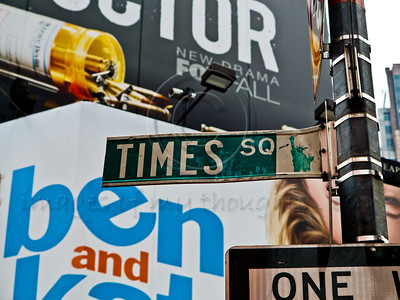 Times Square street sign. New York, New York, USA. 23-July-2012. New York, the most populous city in the US, the cultural and financial capitals of the world, is overwhelming. Diversity is tremendous and the rhythm and power of the city vertiginous. They say you either love it or hate it - I am still undecided.