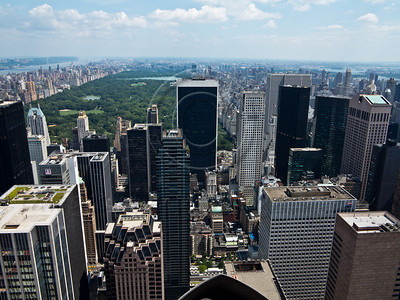A view of Manhattan and Central Park looking north at Top of the Rock Observation Deck at the Rockefeller Center. New York, New York, USA. 24-July-2012. New York, the most populous city in the US, the cultural and financial capitals of the world, is overwhelming. Diversity is tremendous and the rhythm and power of the city vertiginous. They say you either love it or hate it - I am still undecided.