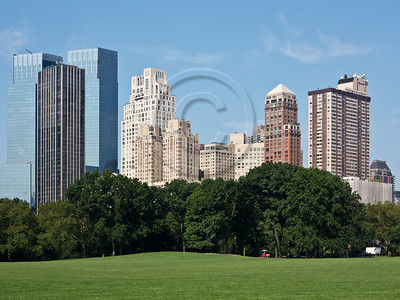 Manhattan skyline as viewed from Central Park. New York, New York, USA. 24-July-2012. New York, the most populous city in the US, the cultural and financial capitals of the world, is overwhelming. Diversity is tremendous and the rhythm and power of the city vertiginous. They say you either love it or hate it - I am still undecided.